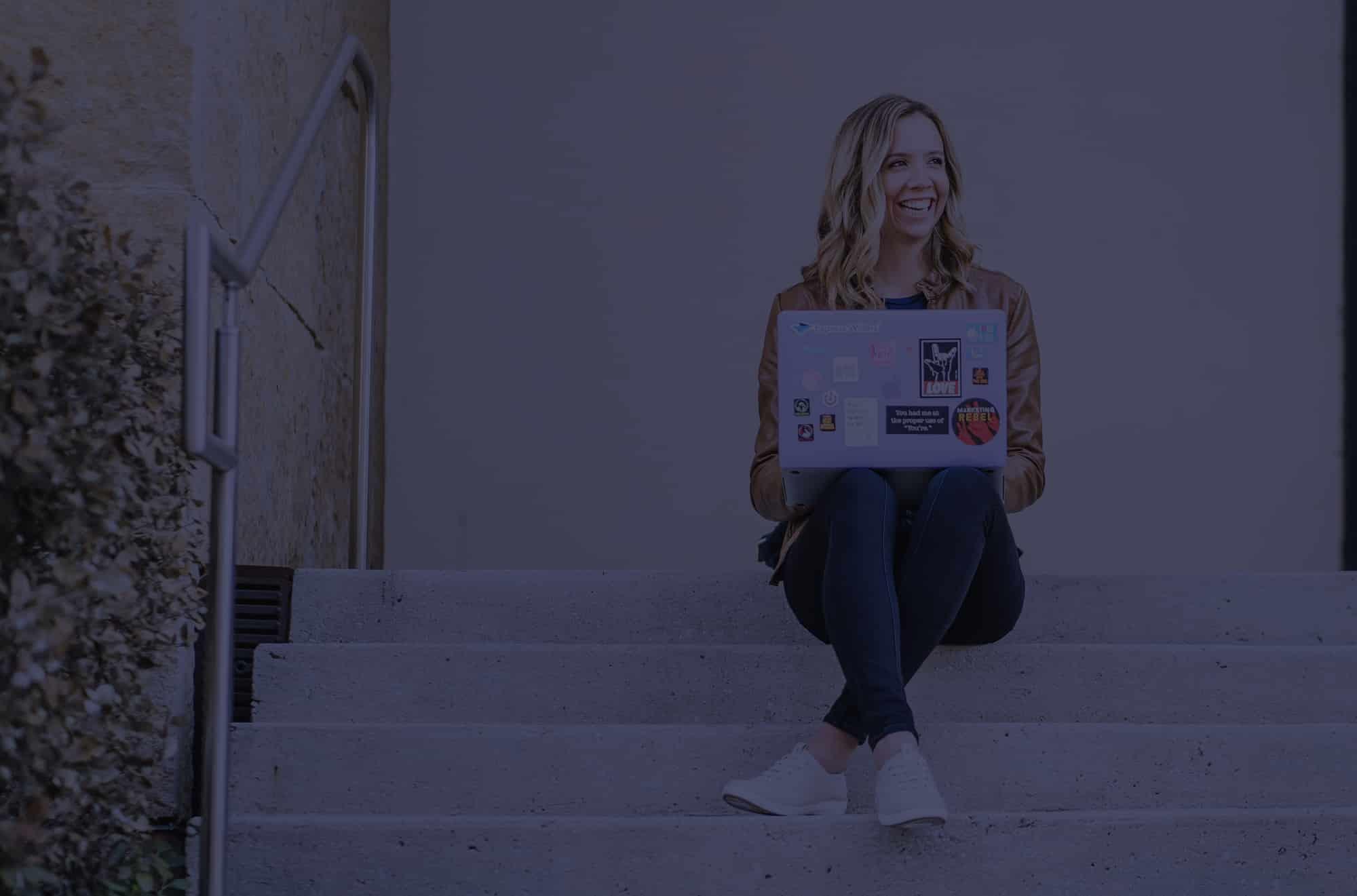 julia mccoy posing with laptop
